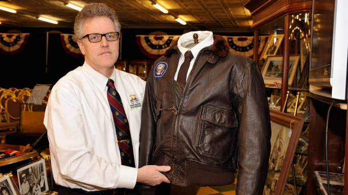 Daniel Meader of John McInnis Auctioneers holds J.F.K.'s 1962 Air Force One Bomber Jacket at the John McInnis Presidential Auction at an auction on February 17, 2013 in Amesbury, Massachusetts.