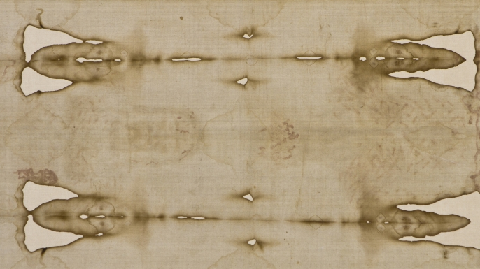 Central detail of the shroud of turin with the face (left).
