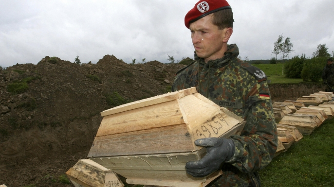A German soldier prepares remains of World War II soldier for burial at Sologubovka Cemetery near St. Petersburg, Russia in 2007.
