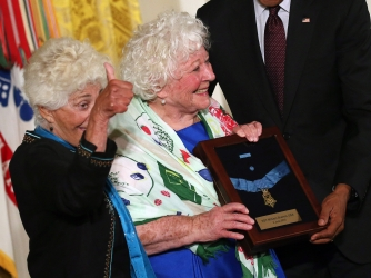 President Obama presents the Medal of Honor to Ina Bass (L) and Elsie Shemin-Roth (C), daughters of Army Sergeant William Shemin. (Credit: Mark Wilson/Getty Images)