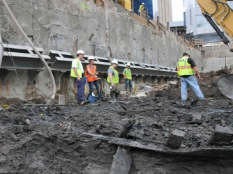 Workers excavating ship from WTC construction site (Credit: Lower Manhattan Development Corporation)