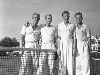 Hunt (left) with doubles partner Sidney Wood and opponents at the men's doubles championship of the Eastern Lawn tennis tournament, 1938. (Credit: Bettmann/Corbis