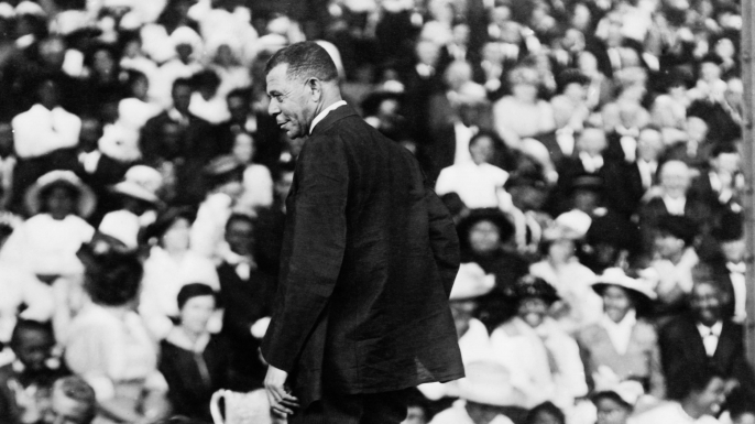 Booker T. Washington addressing a large crowd, circa 1910.