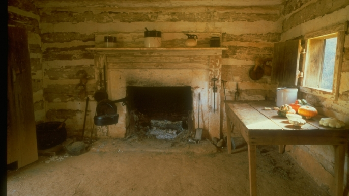 Reconstruction of the cabin where Washington lived with his mother, now part of the Booker T. Washington National Monument. (