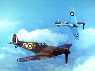 A Supermarine Spitfire (foreground) and a Hawker Hurricane. (Credit: Fox Photos/Getty Images)