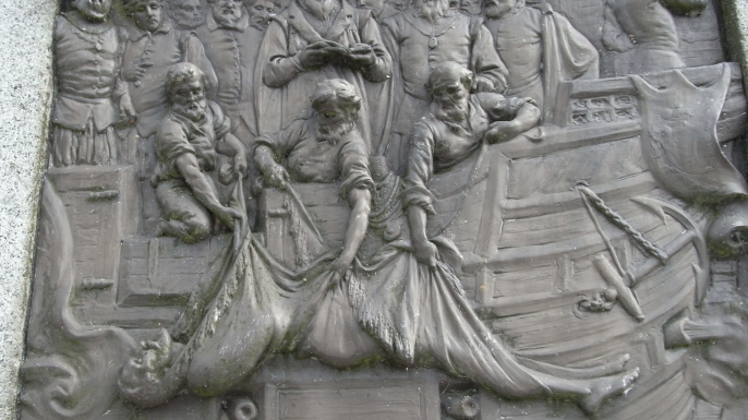 Plaque depicting Drake being buried at sea.