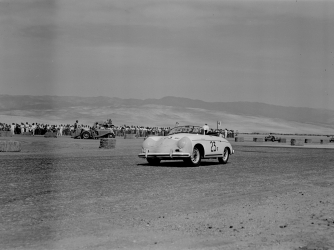Actor James Dean (#23) rounds the first turn in his Porsche 356 Speedster at the 8th Palm Springs Road Race, March, 26-27, 1955. (Credit: Bob D'Olivo/Getty Images)