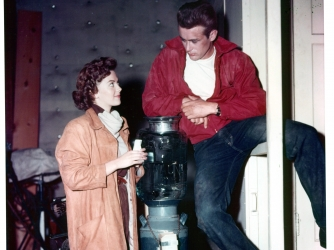Natalie Wood talks with James Dean on set of the film 'Rebel Without A Cause' in 1955. (Credit: Warner Brothers/Getty Images)