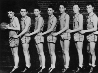 Fairmount High Quakers basketball player James Dean (second from left) poses for a portrait with his teammates in 1947. (Credit: Michael Ochs Archives/Getty Images)
