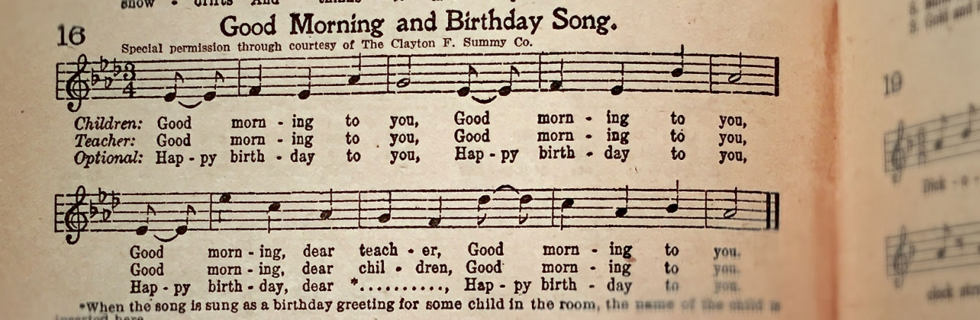 """A 1927 copy of """"The Everyday Song Book,"""" featuring lyrics to """"Happy Birthday."""""""