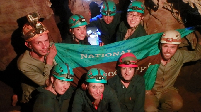 "The ""Underground Astronauts"" pose with Rick Hunter and Steve Tucker, who discovered the Dinaledi Chamber. (Credit: Elizabeth Fitzgerald/National Geographic)"