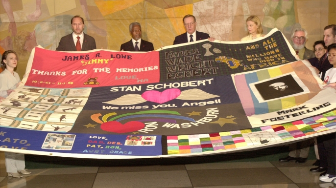 United Nations Secretary General Kofi Annan, background second from left, holds an AIDS memorial quilt during opening ceremonies of the United Nations three-day session on AIDS June 25, 2001 in New York City. (Credit: Spencer Platt/Getty Images)