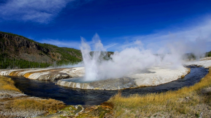 Cliff Geyser along Iron Creek in the Black Sand Basin in Yellowstone National Park in Wyoming.  (Credit: Karen Bleier/Getty Images)