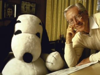 Cartoonist Charles M. Schulz with a life-size Snoopy puppet. (Credit: Matthew Naythons/Getty Images)