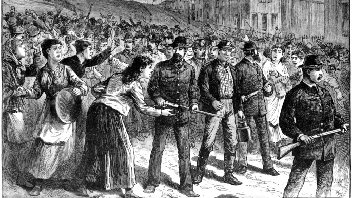 Pinkerton guards break up a strike in Buchtel, Ohio in 1884.