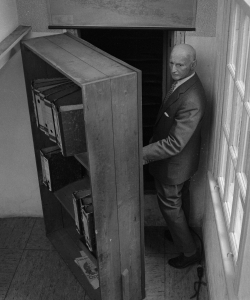 Otto Frank in front of the annex's bookcase, July 1964. (Credit: CBS/Getty Images)