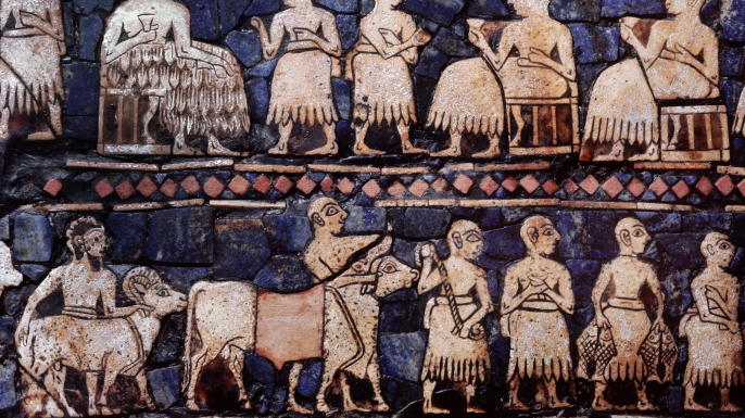 A detail from the so called Standard of Ur, side B. This panel shows a banquet, perhaps after a victory and men driving cattle and sheep. (Credit: Werner Forman/Universal Images Group/Getty Images)