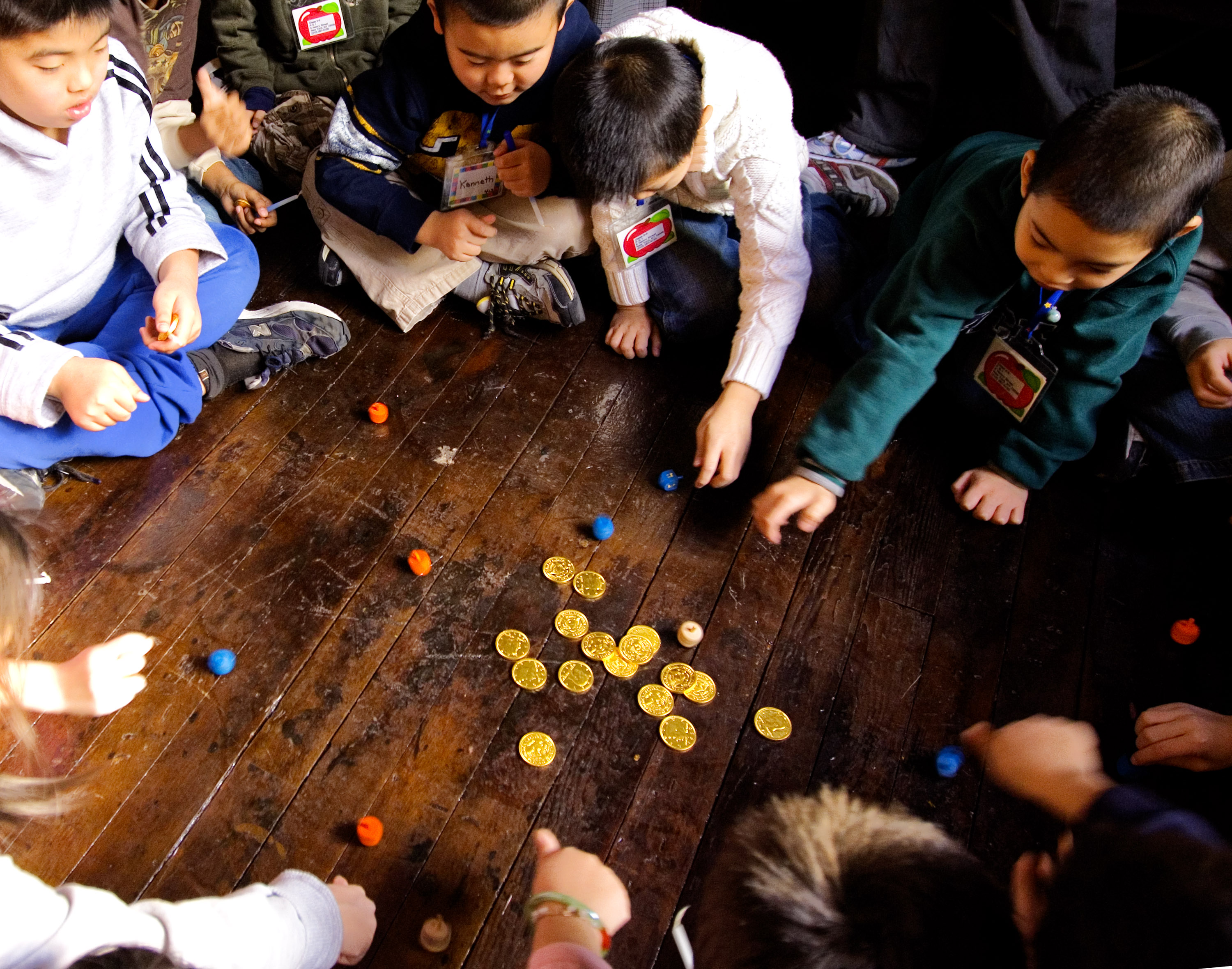 8 things you should know about hanukkah history lists second grade students play with dreidels and chocolate gold coins credit stephen chernin biocorpaavc