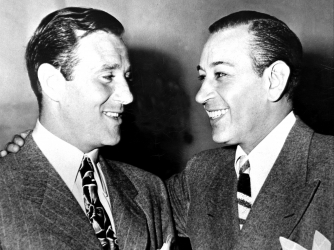 Benjamin Bugsy Siegel talks to George Raft. (Credit: NY Daily News Archive/Getty Images)