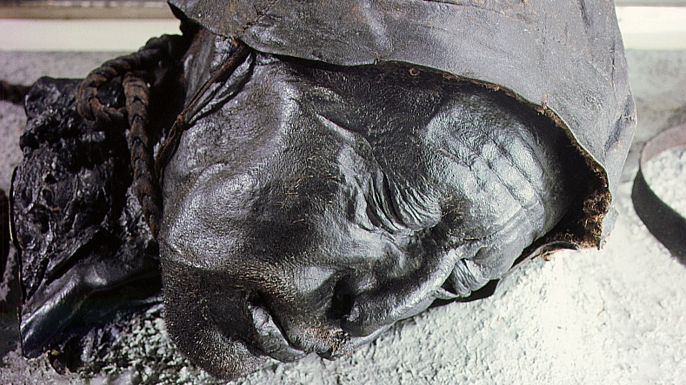 """Tollund man, one of the most well preserved """"bog bodies."""" (Credit: Werner Forman/Universal Images Group/Getty Images)"""