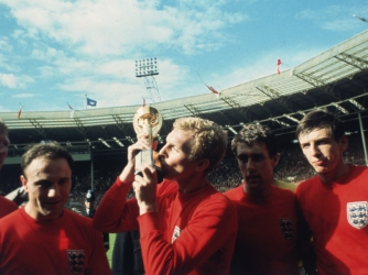Captain Bobby Moore kissing the trophy following England's victory. (Credit: Hulton Archive/Getty Images)