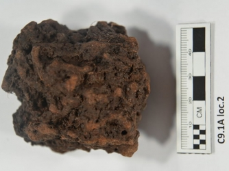 Sample being tested from Point Rosee. Scientists believe it is a lump of bog iron ore. (Credit Greg Mumford)