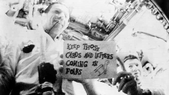 Astronauts Walter M. Schirra Jr. (on right) and Donn F. Eisele are seen in the first live television transmission from space. (Credit: NASA)