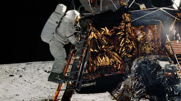 Astronaut Alan L. Bean, lunar module pilot for the Apollo 12 mission, is about to step off the ladder of the Lunar Module. (Credit: NASA)