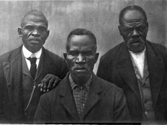 (From left to right) Romeo, Ward Lee, Tucker Henderson, were captured and brought to America on Wanderer.  This picture was taken after they were freed.
