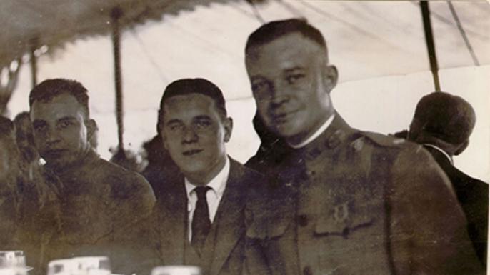 At the Firestone Homestead, Columbiana, Ohio / Sunday, July 13, 1919, A Rest Halt / Major Brett, Harvey Fireston, Jr., Colonel Eisenhower. (Credit: Eisenhower Collection)
