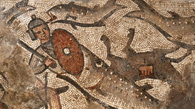 Portion of the mosaic depicting a fish swallowing a soldier during the parting of Red Sea. (Credit: Jim Haberman/Baylor University)