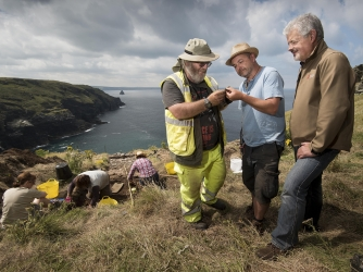 Tintagel Castle Archeology dig. L-R Ryan Smith (Trench Supervisor), James Gossip (Exec Director) and Win Scutt (Properties Curator West). (Credit: Emily Whitfield-Wicks for English Heritage)
