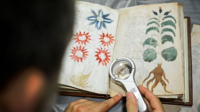 Luis Miguel, of the Spanish publishing company Siloe, Luis Miguel works on the replica of the Voynich Manuscript.