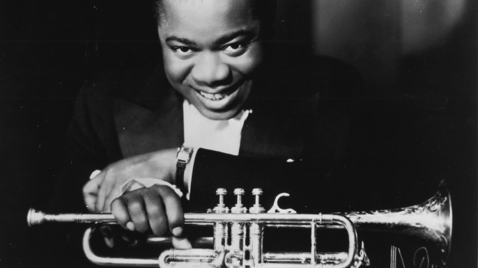 louis Armstrong with trumpet, late 1920s. (Credit: Gilles Petard/Redferns)