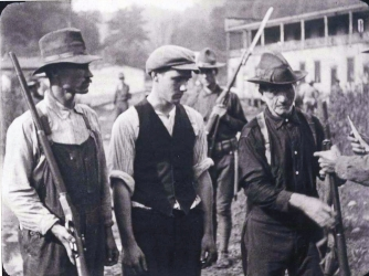 Miners from Battle of Blair Mountain giving up their guns.