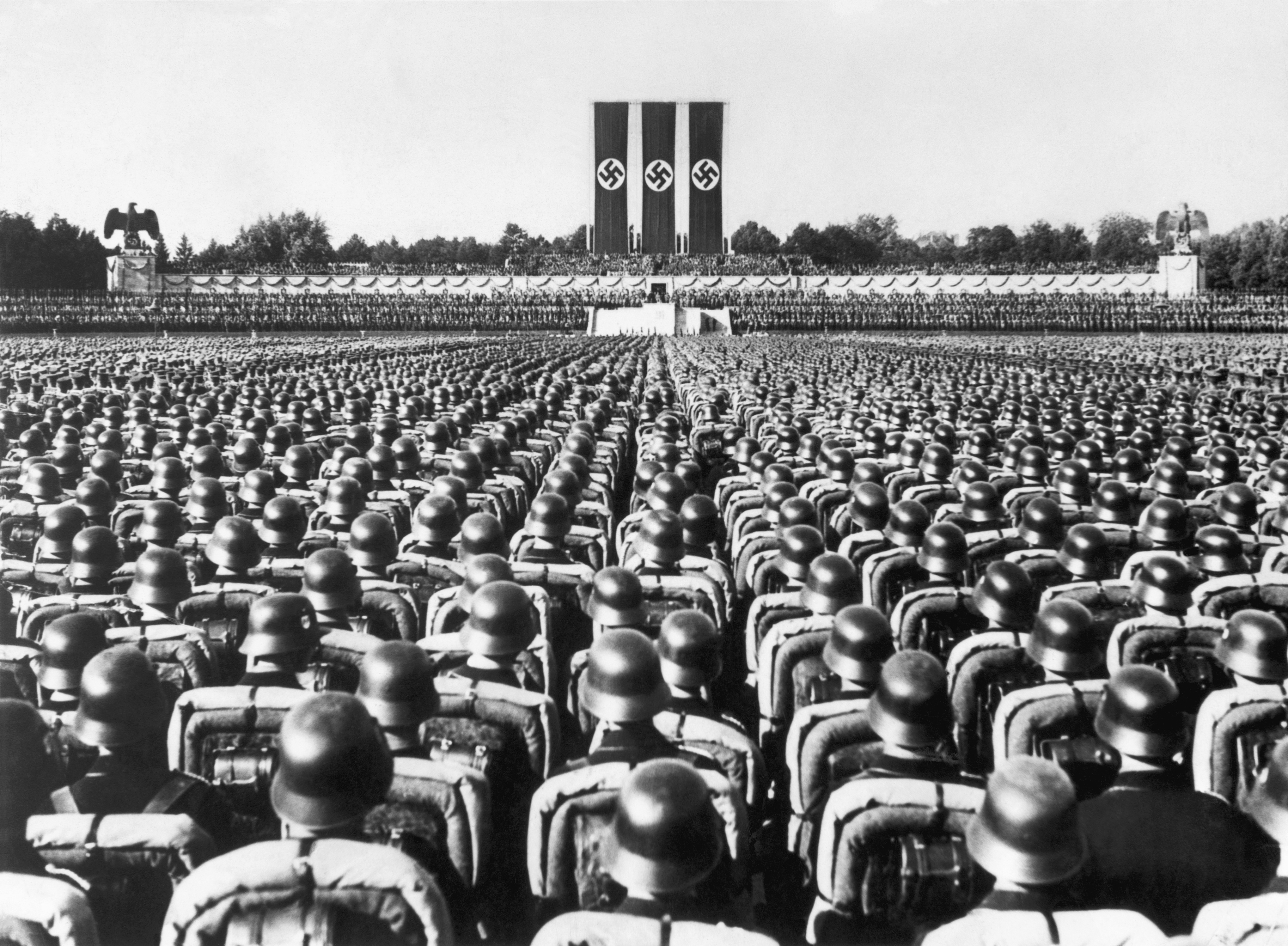 10 things you may not know about the nuremberg trials history lists a huge crowd of soldiers stands at attention beneath the reviewing stand at a 1936 nazi biocorpaavc Image collections