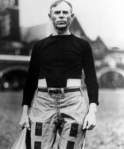 John Heisman standing on Bowman Field, on the Clemson University Campus. (Credit: Public Domain)