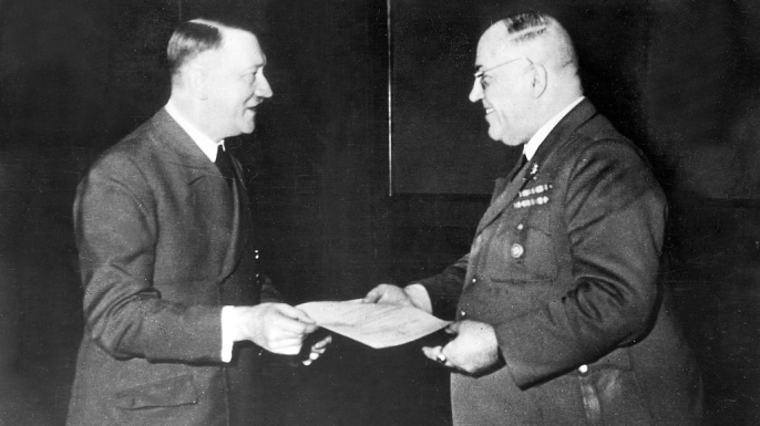 Hitler presents Morell the Knight's Cross, c. 1944. (Credit: Heinrich Hoffmann/ullstein bild via Getty Images)