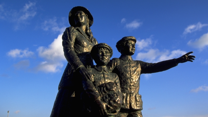 Statue of Annie Moore and her brothers, the first of 17 million Irish to be processed at Ellis Island. (Credit: Jan Butchofsky/Getty Images)