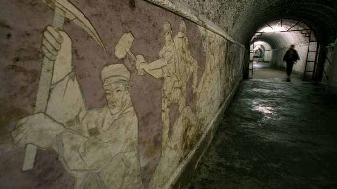 A mural dedicated to the workers who dug the tunnels that later became the Beijing Underground City in Beijing, China. (Credit: Bryan Chan/Los Angeles Times/Getty Images)