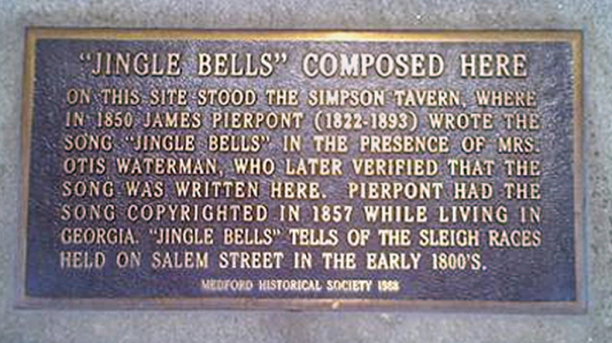 "Plaque commemorating the authorship of the song ""Jingle Bells"" by James Pierpont at the Simpson Tavern (now 19 High Street) in Medford, Massachusetts. Plaque provided by the Medford Historical Society. (Credit: Public Domain)"