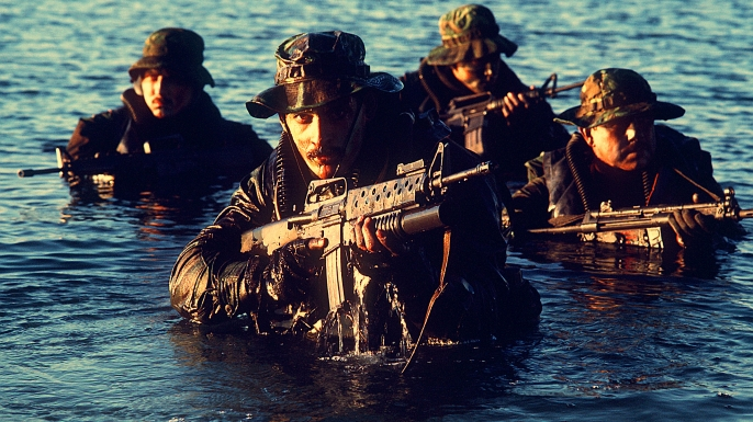 Squad of SEALs in the water, c. 1986. (Credit: U.S. Department of Defense)