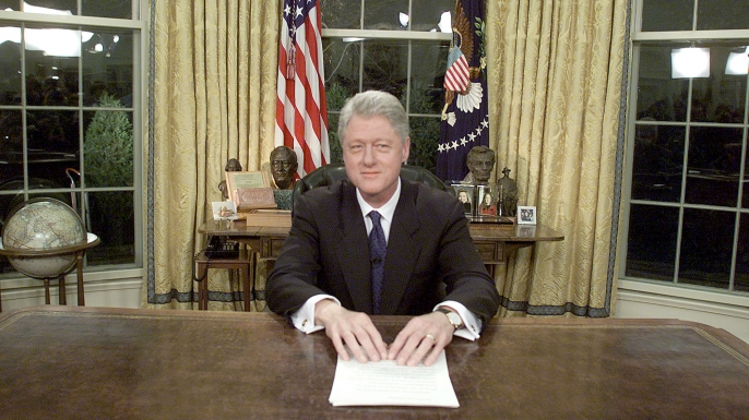 US President Bill Clinton poses for photographers January 18, 2001 after delivering his farewell address to the nation. (Credit: Mark Wilson/Newsmakers)