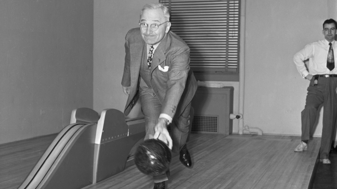 President Harry Truman bowls at the newly-installed White House bowling alley.  (Credit: Marion Carpenter/Getty Images)