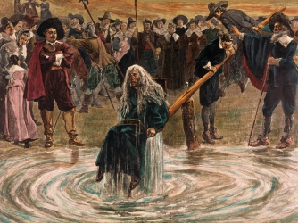 An accused witch going through the judgement trial, where she is dunked in water to prove her guilt of practicing witchcraft. (Credit: Bettmann/Getty Images)