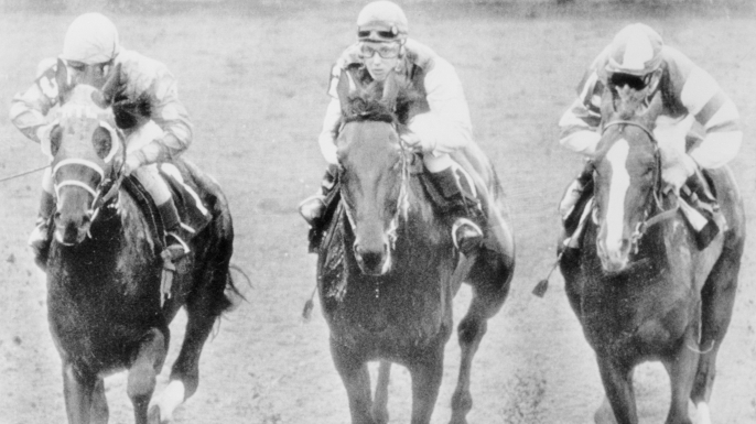 Diane Crump (center),  the first woman to compete in a regular event in U.S. thoroughbred racing history. (Credit: Bettmann/Getty Images)