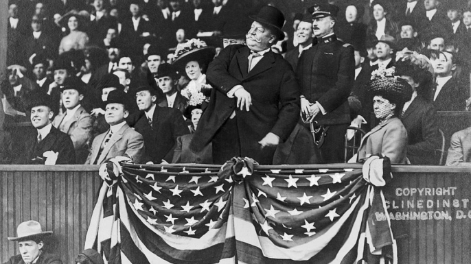 President William Howard Taft throwing out a ceremonial pitch.