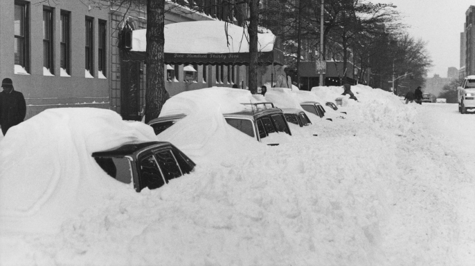 Snowdrifts covering parked cars on 110th Street after more than 20 inches of snow fell in two days in New York City in 1996. (Credit: Barbara Alper/Getty Images)