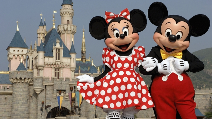 Mickey and Minnie Mouse in front of the Sleeping Beauty Castle. (Credit: Mark Ashman/Disney/Getty Images)