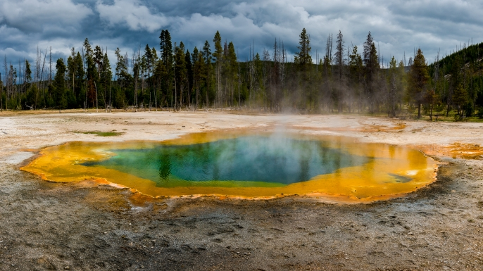 The pools steam and bubble of the supervolcano in Yellowstone National Park, Wyoming, United States. (Credit: Russell Pearson/Barcroft Images/Getty Images)
